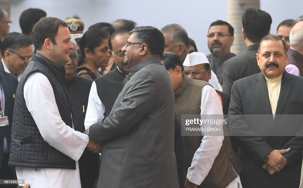Indian Congress Party President-elect Rahul Gandhi (L) meets with Bhartiya Janata Party (BJP) MPs during a remembrance ceremony for the 2001 attack on Parliament at Parliament House in New Delhi on December 13, 2017. Politicans gathered to observe the sixteenth anniversary of a bloody militant attack on the complex, which left 14 dead on December 13, 2001. /