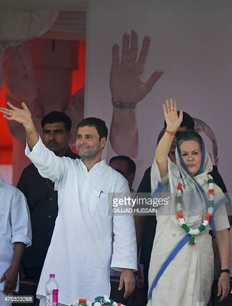 Indian Congress Party vicepresident Rahul Gandhi and Congress President Sonia Gandhi wave to supporters during a rally in New Delhi on April 19 2015...
