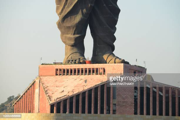 Indian construction workers are seen at the plimth structure the Statue Of Unity the world's tallest statue dedicated to Indian independence leader...