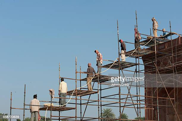 indian construction workers on scaffolding - construction worker stock pictures, royalty-free photos & images