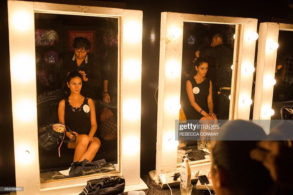 Indian contestants have their hair and make-up styled as they prepare to take part in the 'Bikini' round of the Miss Diva Universe 2014 auditions in New Delhi on August 27, 2014. The Miss Diva Universe 2014 pageant is holding auditions in ten cities across India ahead of the contest finale in September. AFP PHOTO/Rebecca Conway