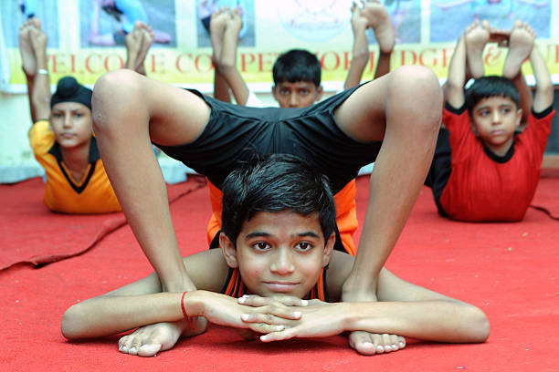 Indian contestants hold a position during the Punjab state Yoga Competition in Amritsar on September 24 2011 275 Yoga players participated in the...