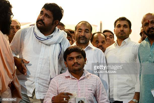 Indian convenor of the 'Patidar Anamat Andolan Samiti' movement Hardik Patel looks on ahead of the start of a press conference in New Delhi on...