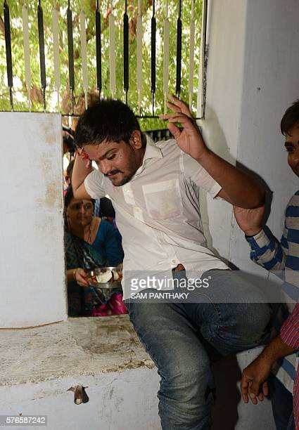 Indian convenor of the Patidar Anamat Andolan Samiti movement Hardik Patel enters his home through a window to avoid media in Viramgam some 60 kms...