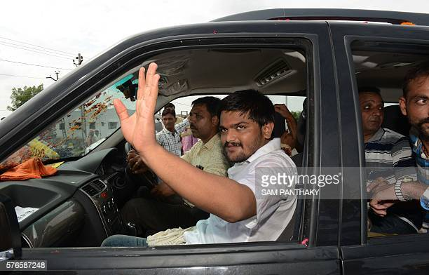Indian convenor of the Patidar Anamat Andolan Samiti movement Hardik Patel waves from a car as he leaves his home town Viramgam some 60 kms from...