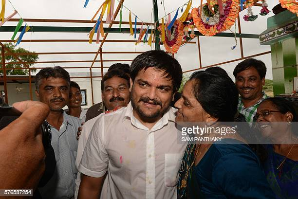 Indian convenor of the Patidar Anamat Andolan Samiti movement Hardik Patel meets with his mother Ushaben after praying in a small temple in his...