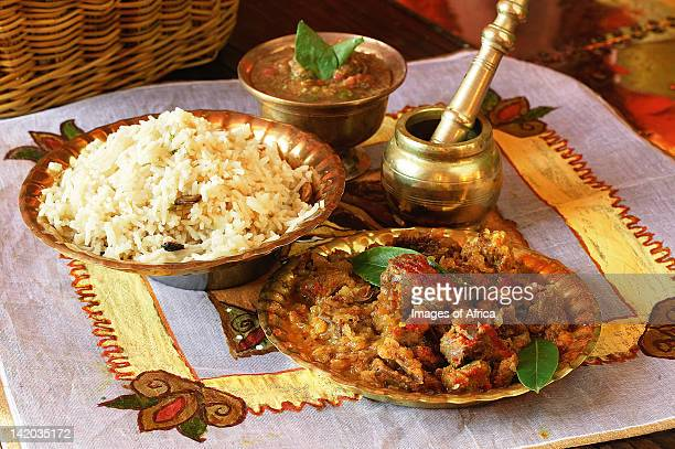 Indian cooking. Sweet-sour lamb cubes served with rice and limri chutney