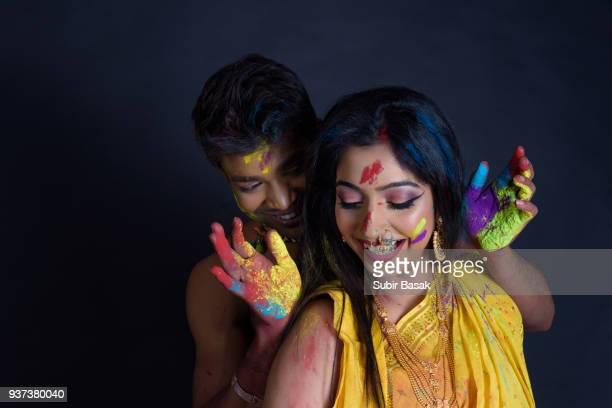 Indian couple celebrating Holi.