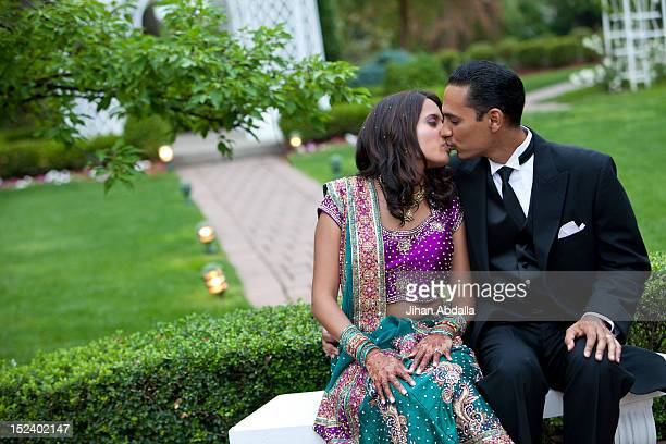 Indian couple in traditional clothing kissing