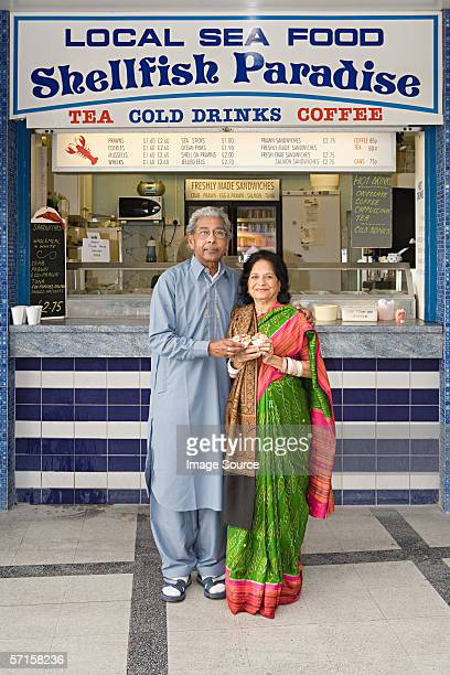 Indian couple outside seafood stall