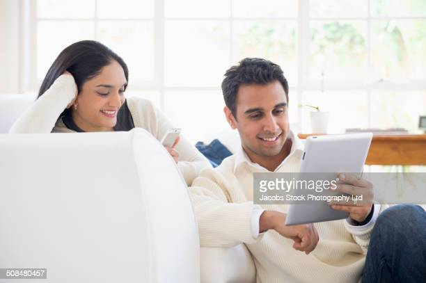 Indian couple relaxing in living room