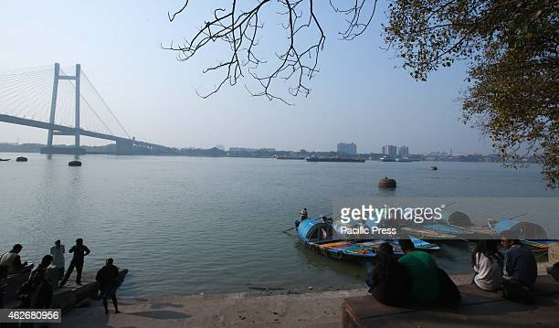 Indian Couple rest on the bank of Hooghly River at Babughat
