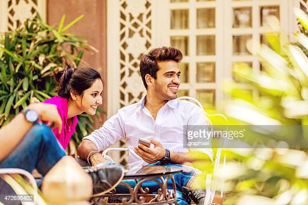 Indian couple sitting in cafe