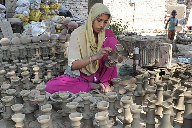 Indian crafts women Bhawana prepares clay lamps ahead of the Hindu festival of Diwali in Amritsar on October 17 2011 Diwali celebrated October 26 is..