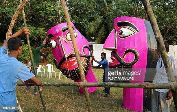 Indian craftsmen carry an effigy of the Hindu demon king 'Ravana' ahead of the Hindu festival of Dussehra in Mumbai on September 29 2014 Held at the...
