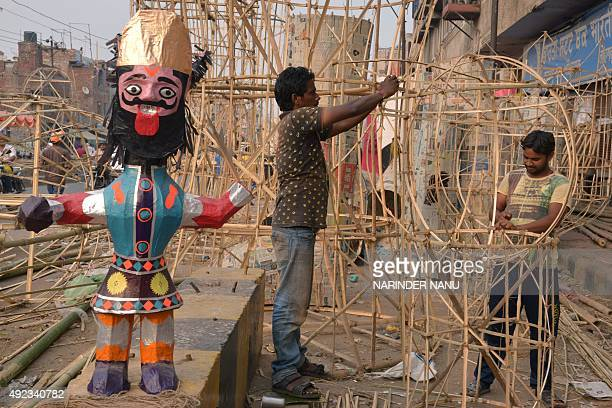 Indian craftsmen make effigies of the Hindu demon king Ravana at a workshop in Amritsar on October 12 ahead of the festival of Dussehra The festival...