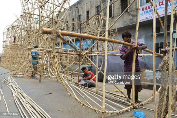 Indian craftsmen make effigies of the Hindu demonking 'Ravana' at a workshop ahead of the Hindu festival of 'Dussehra' in Amritsar on September 22...