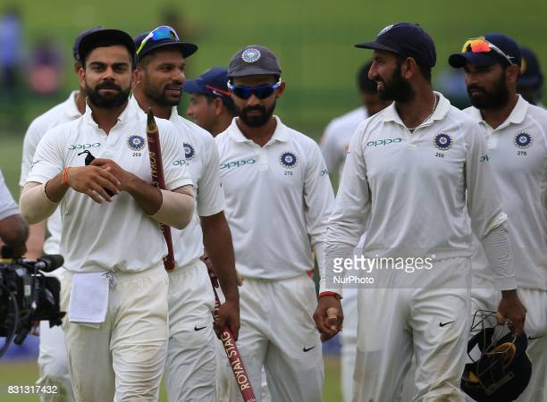 Indian cricket captain and his team walk back to the pavilion after winning the 3rd Test during the 3rd Day's play in the 3rd and final Test match...