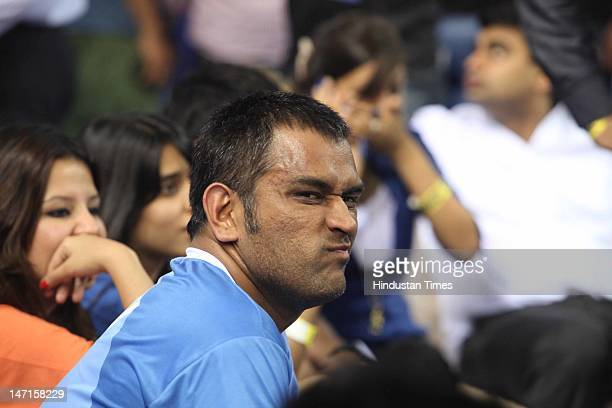 Indian Cricket captain Mahendra Singh Dhoni at an exhibition indoor football match at the Pepsi T20 Football finale on June 17 2012 in New Delhi India
