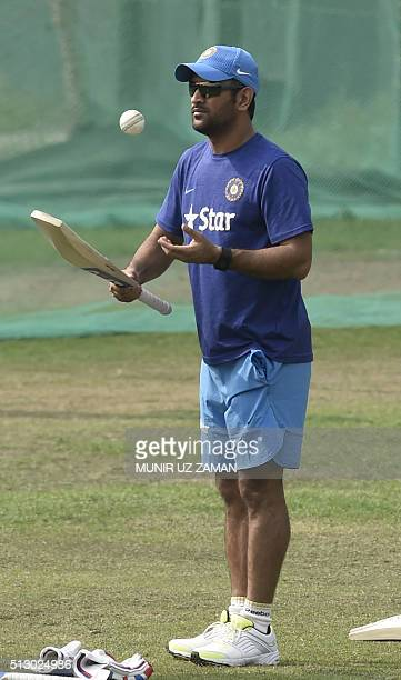 Indian cricket captain Mahendra Singh Dhoni attends a training session at the ShereBangla National Cricket Stadium in Dhaka on February 29 2016 AFP...