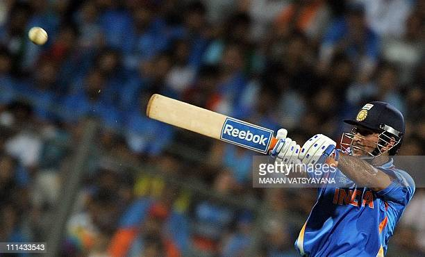 Indian cricket captain Mahendra Singh Dhoni hits a boundary during the ICC Cricket World Cup 2011 Final match at The Wankhede Stadium in Mumbai on...
