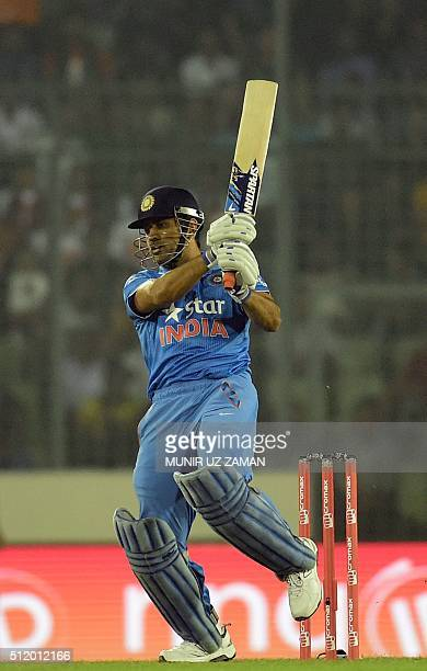 Indian cricket captain Mahendra Singh Dhoni plays a shot during a Twenty20 cricket match between India and Bangladesh for the Asia Cup T20 cricket...