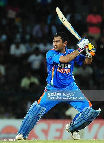 Indian cricket captain Mahendra Singh Dhoni plays a shot during the third one day international match between Sri Lanka and India at the RPremadasa...