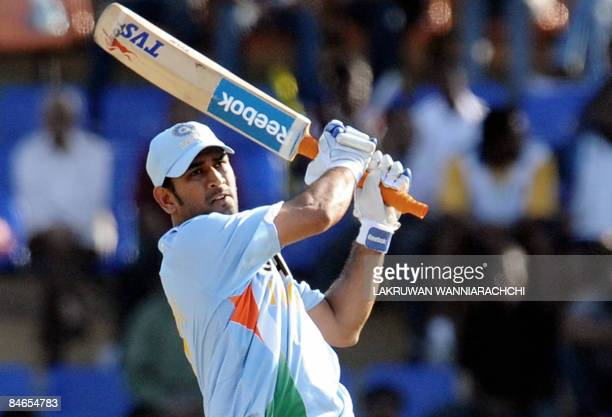 Indian cricket captain Mahendra Singh Dhoni plays a stroke during the fourth One Day International match between India and Sri Lanka at the R....