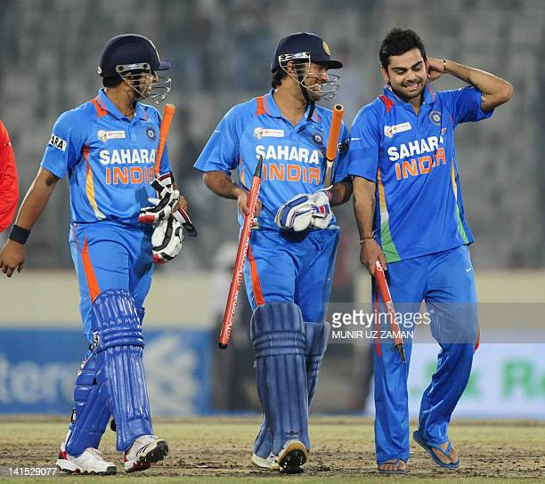 Indian cricket captain Mahendra Singh Dhoni , Virat Kholi and Suresh Raina leave the field after India won the one day international Asia Cup cricket...