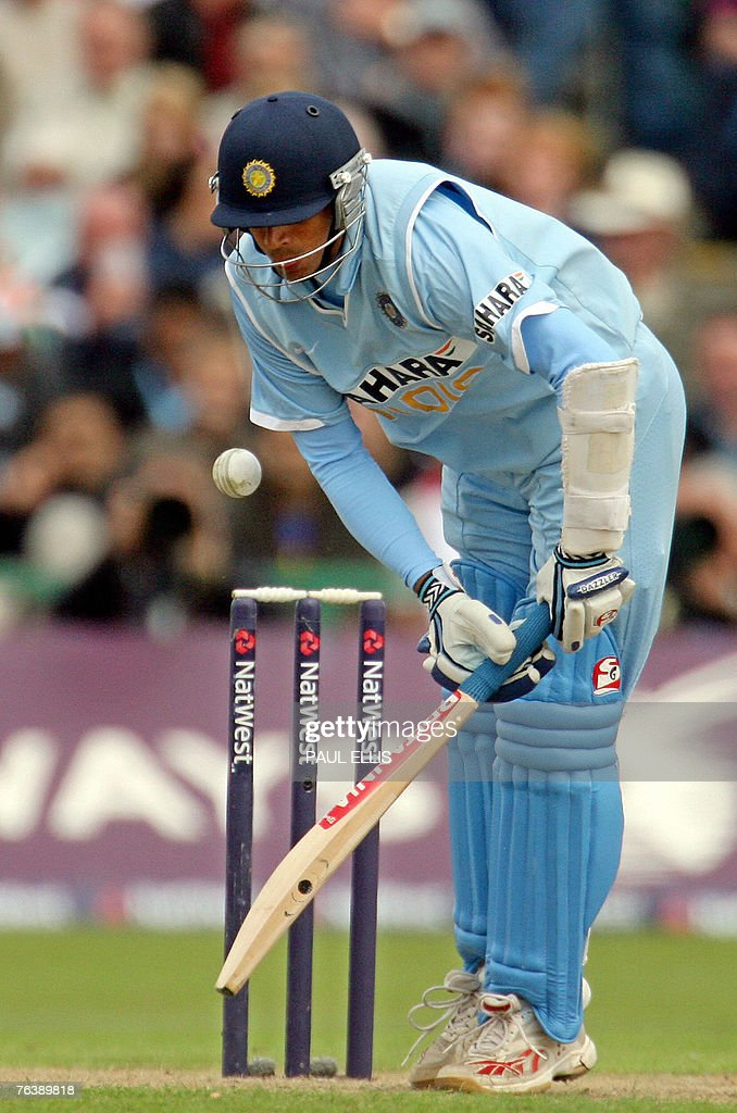 Indian cricket captain Rahul Dravid plays a shot before being dismissed by England bowler Andrew Flintoff (not seen) for 1 run during their One Day International cricket match at Old Trafford, Manchester, north-west England, 30 August 2007.