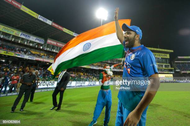 Indian cricket captain Rohit Sharma acknowledges the Sri Lankan fans who supported the Indian cricket team during the final Twenty-20 cricket match...