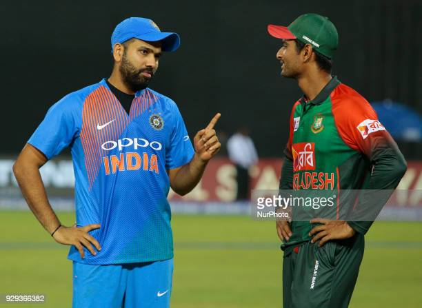 Indian cricket captain Rohit Sharma and Bangladesh cricket captain Mahmudullah Riyad are seen in a conversation during the 2nd T20 cricket match of...