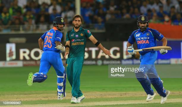 Indian cricket captain Rohit Sharma and Shikhar Dhawan run between the wickets during the 5th cricket match of Asia Cup 2018 between India and...