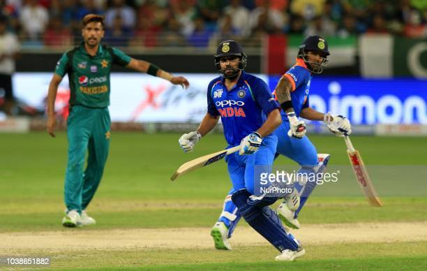 Indian cricket captain Rohit Sharma and Shikhar Dhawan run between the wickets during the Asia Cup 2018 cricket match between India and Pakistan at...
