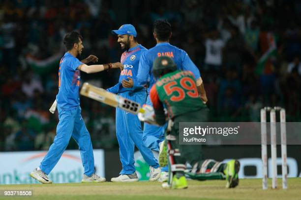 Indian cricket captain Rohit Sharma and Yuzvendra Chahal celebrate during the final Twenty20 cricket match of NIDAHAS Trophy between Bangladesh and...