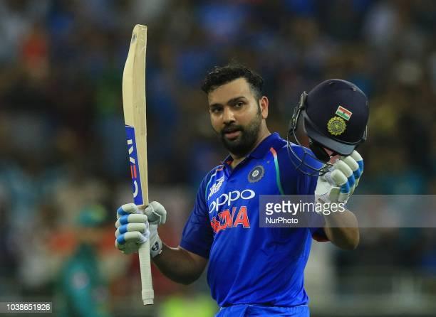 Indian cricket captain Rohit Sharma celebrates after scoring 100 runs during the Asia Cup 2018 cricket match between India and Pakistan at Dubai...