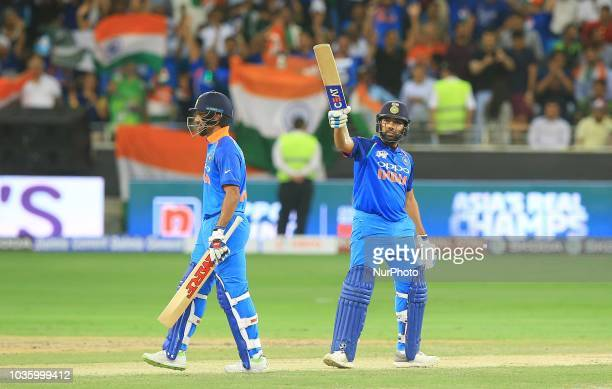 Indian cricket captain Rohit Sharma celebrates after scoring 50 runs during the 5th cricket match of Asia Cup 2018 between India and Pakistan at...