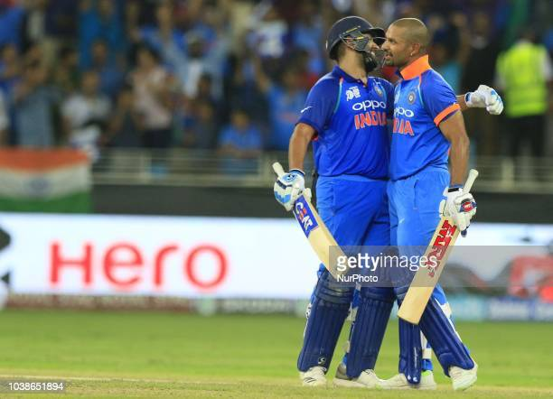 Indian cricket captain Rohit Sharma celebrates with Shikar Dhawan after Dhawan scored 100 runs during the Asia Cup 2018 cricket match between India...