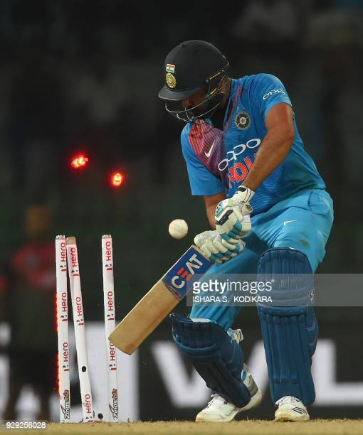 Indian cricket captain Rohit Sharma gets dismissed by Bangladesh cricketer Mustafizur Rahman during the second Twenty20 international cricket match...