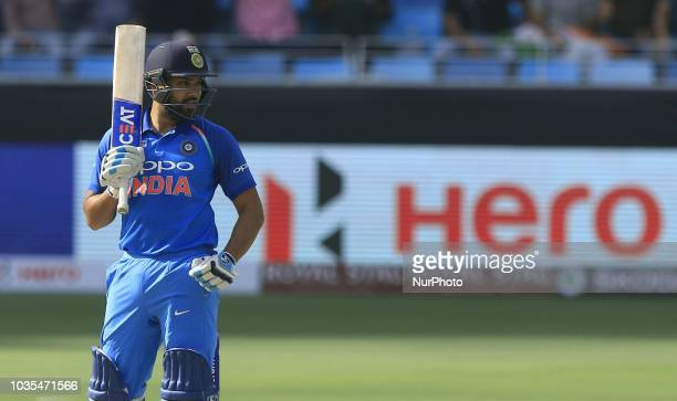 Indian cricket captain Rohit Sharma looks on during the 4th cricket match of Asia Cup 2018 between India and Hong Kong at Dubai International cricket...