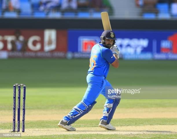 Indian cricket captain Rohit Sharma plays a shot during the 4th cricket match of Asia Cup 2018 between India and Hong Kong at Dubai International...