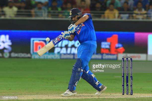 Indian cricket captain Rohit Sharma plays a shot during the 5th cricket match of Asia Cup 2018 between India and Pakistan at Dubai International...