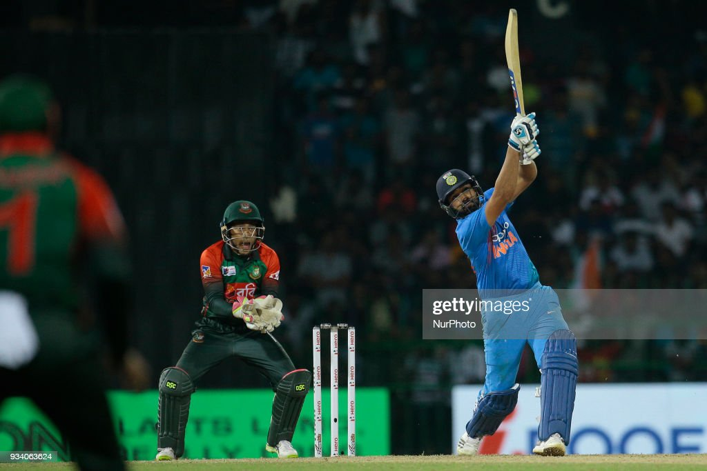 Indian cricket captain Rohit Sharma plays a shot during the final Twenty-20 cricket match of NIDAHAS Trophy between Bangladesh and India at R Premadasa cricket ground, Colombo, Sri Lanka on Sunday 18 March 2018.