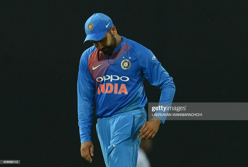 Indian cricket captain Rohit Sharma reacts after Sri Lanka's victory in the opening Twenty20 international cricket match between Sri Lanka and India for the Nidahas Trophy tri-nation Twenty20 tournament at The R. Premadasa Stadium in Colombo on March 6, 2018. The Nidahas Trophy tri-nation Twenty20 tournament involving Sri Lanka, Bangladesh and India. /