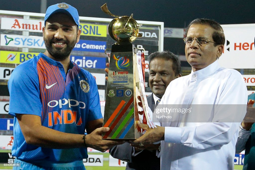 Indian cricket captain Rohit Sharma (L) receives the NIDAHAS Trophy by Sri Lankan president Maithripala Sirisena after winning the final Twenty-20 cricket match of NIDAHAS Trophy between Bangladesh and India at R Premadasa cricket ground, Colombo, Sri Lanka on Sunday 18 March 2018.