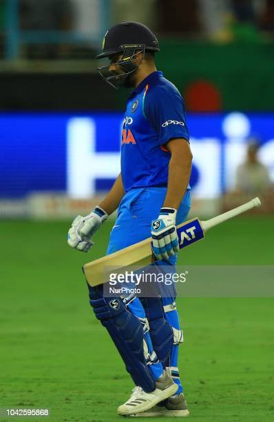 Indian cricket captain Rohit Sharma walks back following his dismissal during the final cricket match of Asia Cup 2018 between India and Bangladesh...
