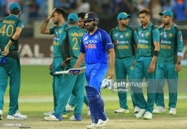 Indian cricket captain Rohit Sharma walks off after the Asia Cup 2018 cricket match between India and Pakistan at Dubai International cricket...