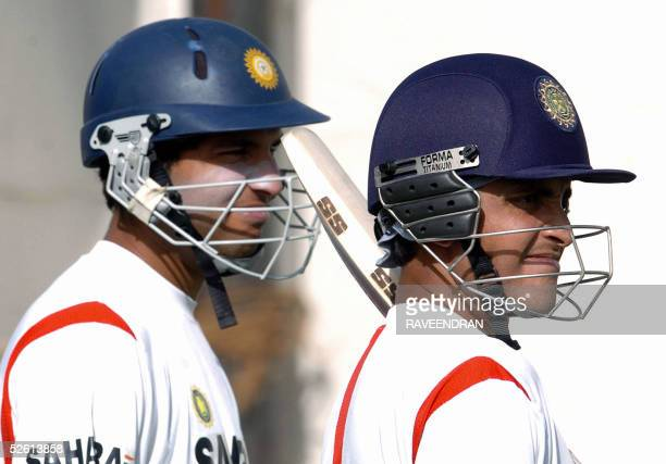 Indian cricket captain Sourav Ganguly and teammate Yuvraj Singh watch proceedings as they wait their turn to go into the nets during a practice...