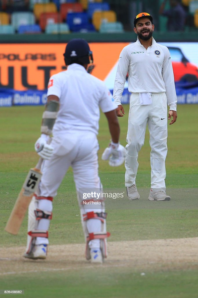 Indian cricket captain Virat Kholi (R) cheers up his team mates during the 2nd Day's play in the 2nd Test match between Sri Lanka and India at the SSC international cricket stadium at the capital city of Colombo, Sri Lanka on Friday 04 August 2017.