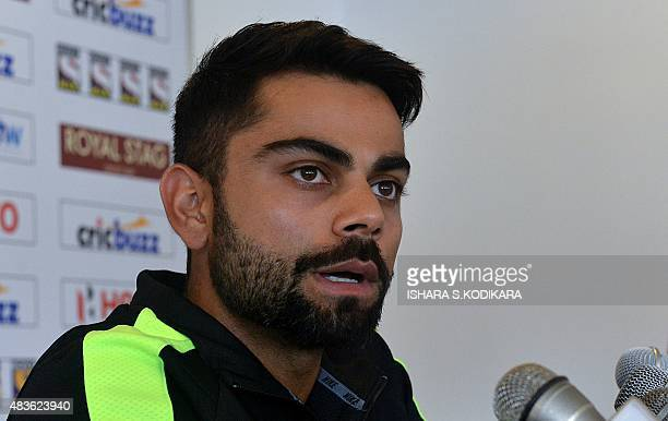 Indian cricket captain Virat Kohli addresses a press conference at the Galle International Cricket Stadium in Galle on August 11 2015 The first Test...